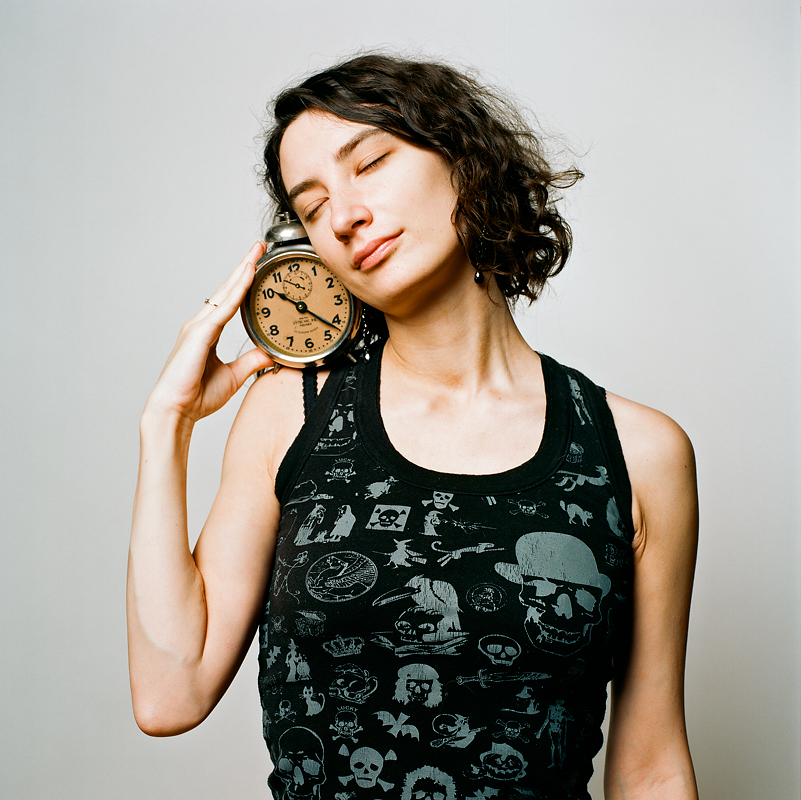 "Masha and a vintage alarm clock, made ""by special command""."